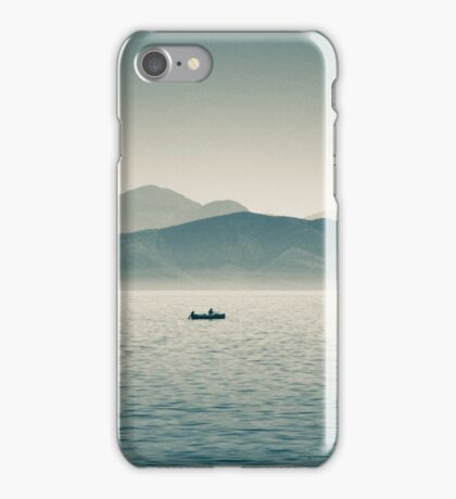 Boat on the sea with mountains iPhone Case/Skin